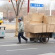 Stock Photo: Bike transport in Chinoverloaded with boxes