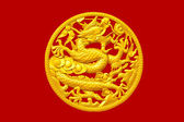 Golden Chinese dragon on red wood background — Stock Photo