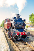 Old vintage steam train drive on the rails — Stock Photo