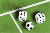 Gambling with dice and football win money — Stock Photo