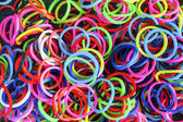 Rainbow loom rubber bands  with colorful fashion bracelet — Stock Photo