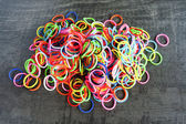 Colorful background Rainbow loom rubber bands fashion — Stock Photo