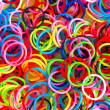 Colorful background rainbow colors rubber bands loom — Stock Photo #49487935