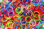 Colorful background rainbow colors rubber bands loom — Stock Photo