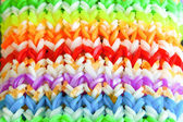 Big colorful rubber rainbow band made on loom — Stock Photo