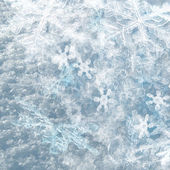 Winter background from snowflakes — Stock Photo