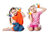 Portrait of a cute girls playing with paints — Foto Stock