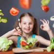 Beautiful girl with fresh vegetables — Stock Photo #44986217