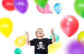 Boy with colorful balloons — Stok fotoğraf