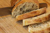 Ciabatta being cut — Stockfoto