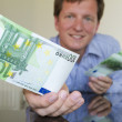 Stock Photo: Giving 100 Euro