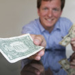 Giving One Dollar — Stock Photo