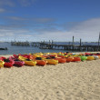 Stock Photo: Line of Kayaks