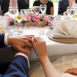 Stock Photo: Hands married couple on table