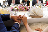 Hands married couple on table — Stock fotografie