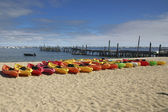 Line of colorful Kayaks — Stock fotografie