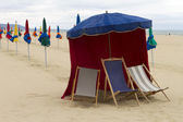 Parasol with chairs on the beach — Stock Photo
