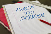 Back to school written in notebook with pencil and slat — Stok fotoğraf