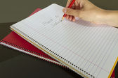 Teacher writing back to school in notebook — Stock Photo