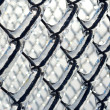 Ice coated chain link fence from an ice storm — Stock Photo #38745699