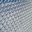 Ice coated chain link fence from an ice storm — Stock Photo #38745803