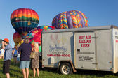 METAMORA, MICHIGAN - AUGUST 24 2013: Colorful hot air balloons launch at the annual Metamora Country Days and Hot Air Balloon Festival. — Stock Photo