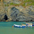 Stock Photo: Boats near cliffs