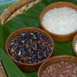 Stock Photo: Four types of rice in wooden plates