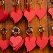Red wooden heart key chain — Stock Photo