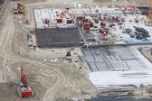 Concrete construction with digger digger, trucks bulldozer — Stock Photo