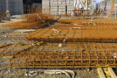 Piled up steel reinforcement frames on a construction site — Stock Photo