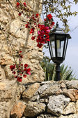 Old style lamp post and stony wall in Sineu — Stock Photo