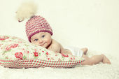 Smiling baby in pink hat — Stock Photo