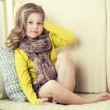 A little girl in a yellow jacket. — Stock Photo #22057951