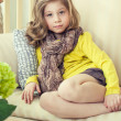A little girl in a yellow jacket. — Stock Photo