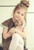 The little girl holds a toy. — Stock Photo