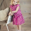 Stock Photo: Little girl in fashion clothes.