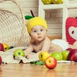 Baby and apples. — Stock Photo