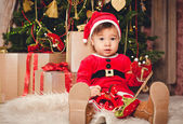 Kid in a Santa suit — Stock Photo