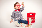 Portrait of a happy Asian boy with glasses. — Stock Photo