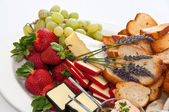 Fruit and cheese platter — Stock Photo