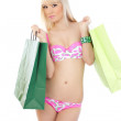 Picture of seductive woman in pink lingerie with shopping bag — Stock Photo #11494679