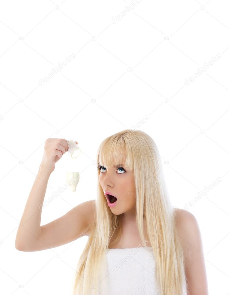 Beautiful woman holding condom and looking up at copyspace — Foto de Stock   #12949143