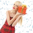 Beautiful blonde woman with christmas gift. Snow flakes — Stock Photo #13333513