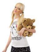 Beautiful blonde girl with teddy bear on white background — Stock Photo