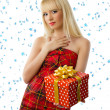 Beautiful blonde woman with christmas gift. Snowflakes — Stock Photo