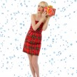 Pretty woman in red dress with christmas gift. Snowflakes — Stock Photo #13768353