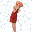 Pretty woman in red dress with christmas gift. Snowflakes — Stock Photo