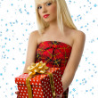 Blonde woman with christmas gift. Snowflakes — Stock Photo