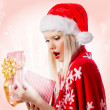 Pretty blonde young woman in red hat with opened gift box — Stock Photo